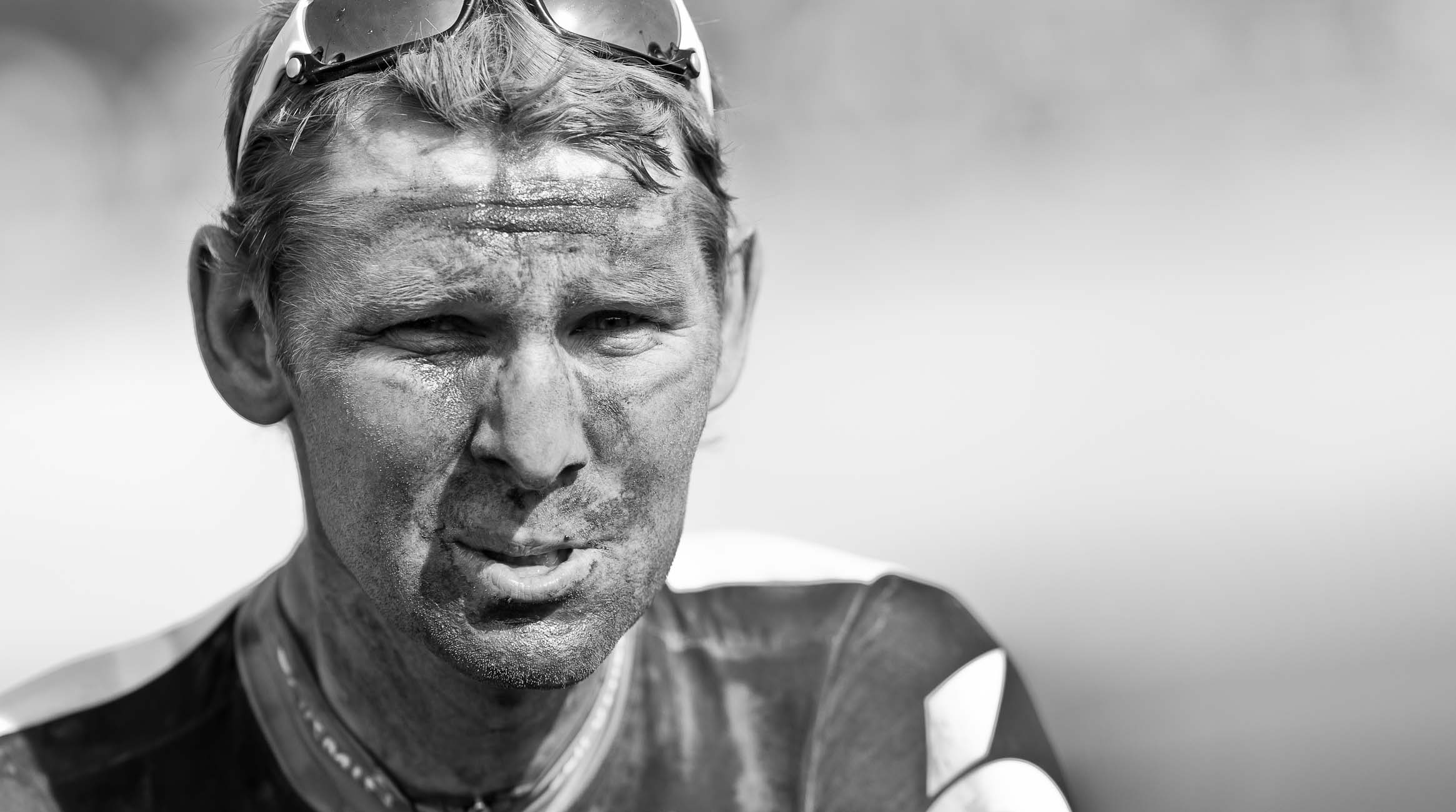 Garmin rider caked with dust and sweat