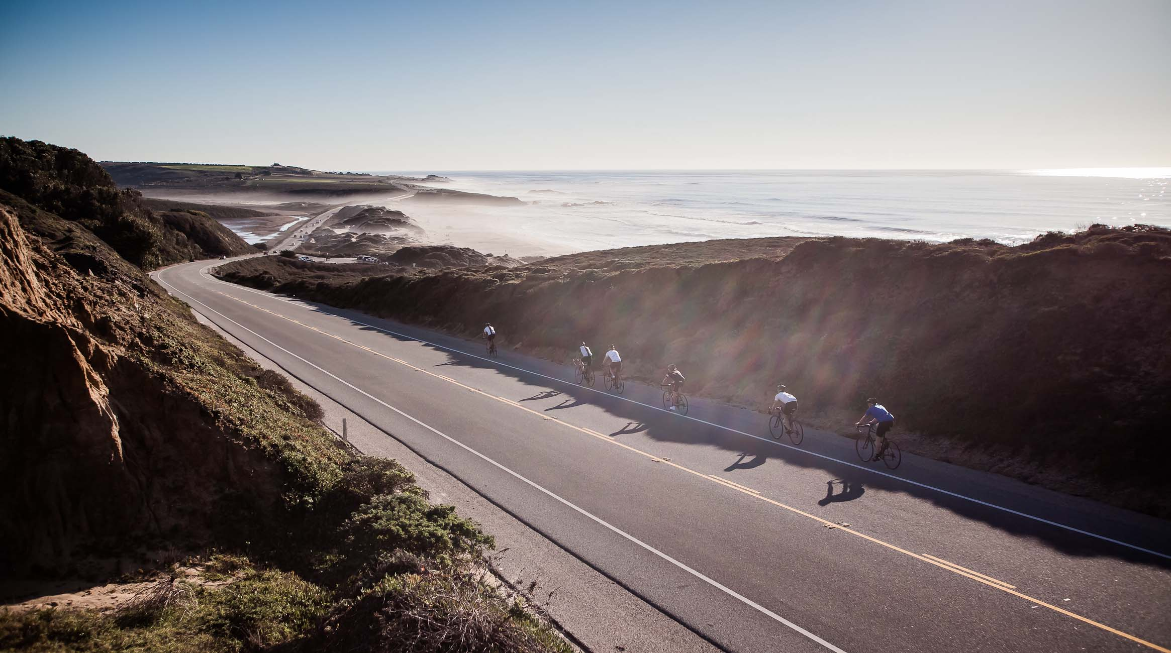 riders descent the PCH