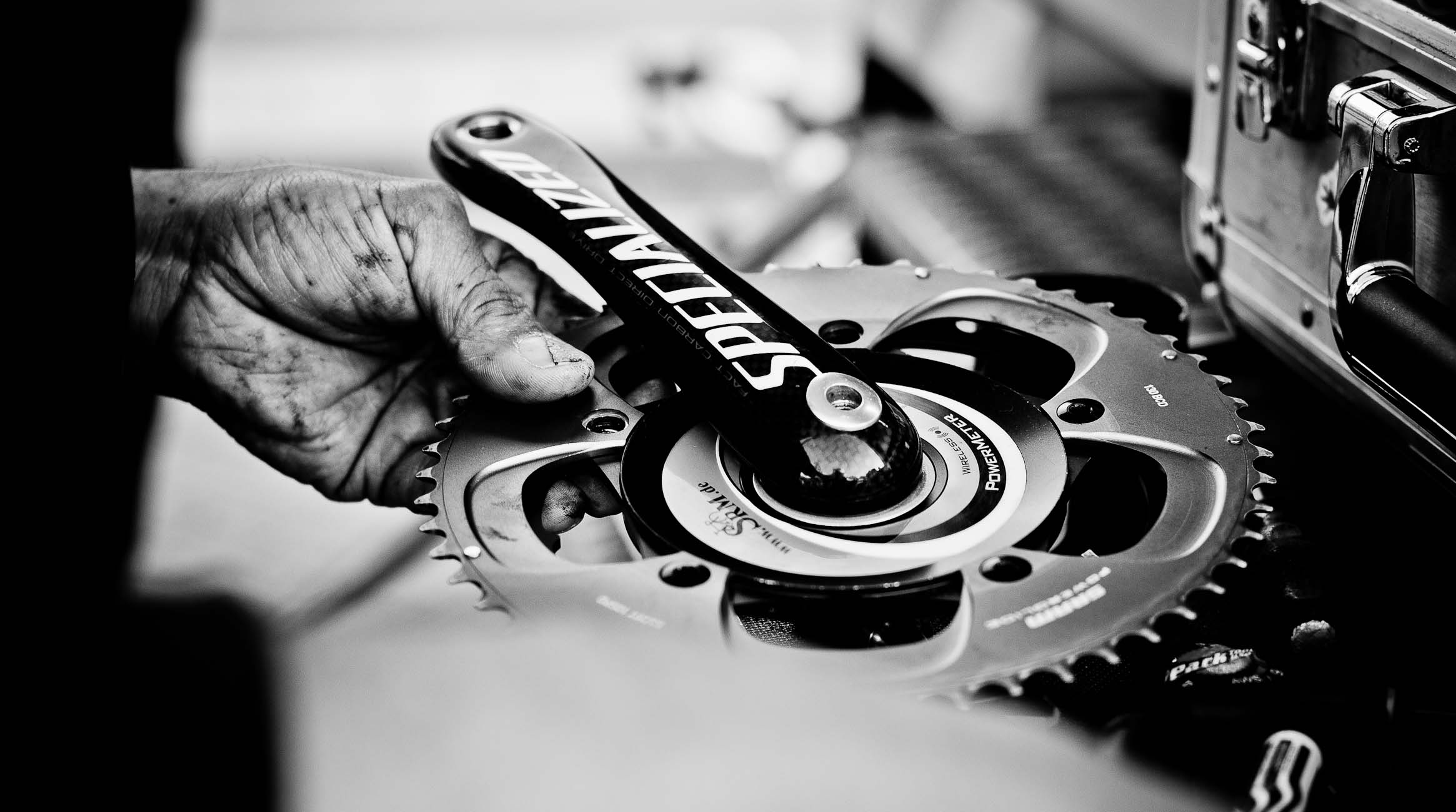 mechanic working on crankset